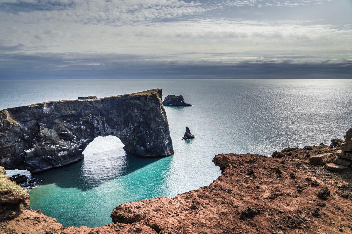 Dyrhólaey arch by the sea in south iceland