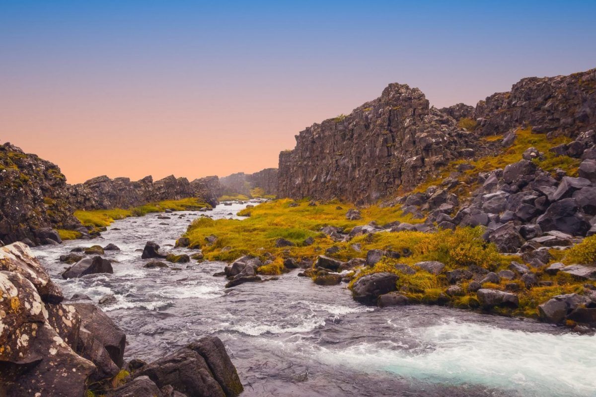 river running between two tectonic plates in thingvellir National Park iceland