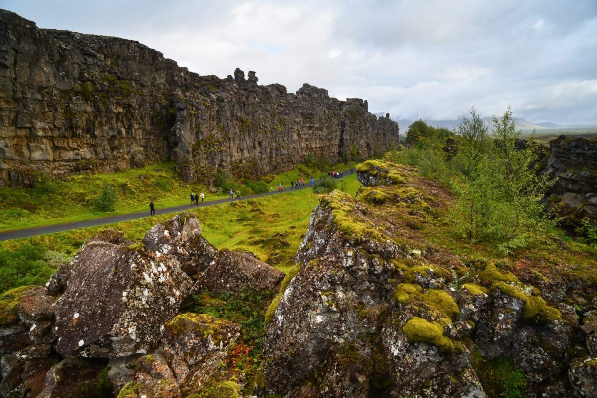 walking between european and american continents in thingvellir national park iceland