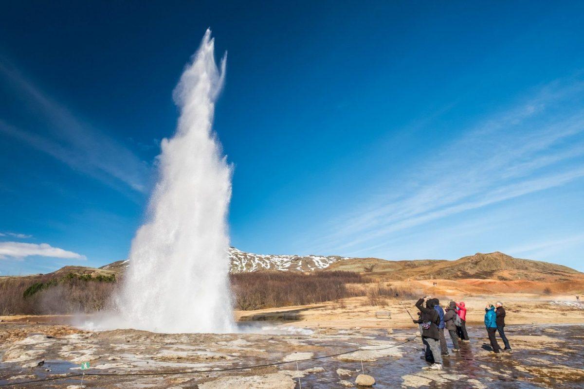 strokkur geyser erupting in the golden circle iceland