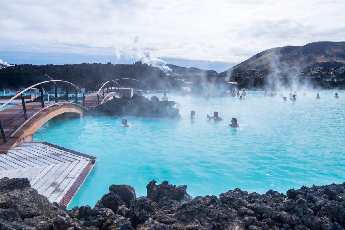 people bathe in blue lagoon iceland