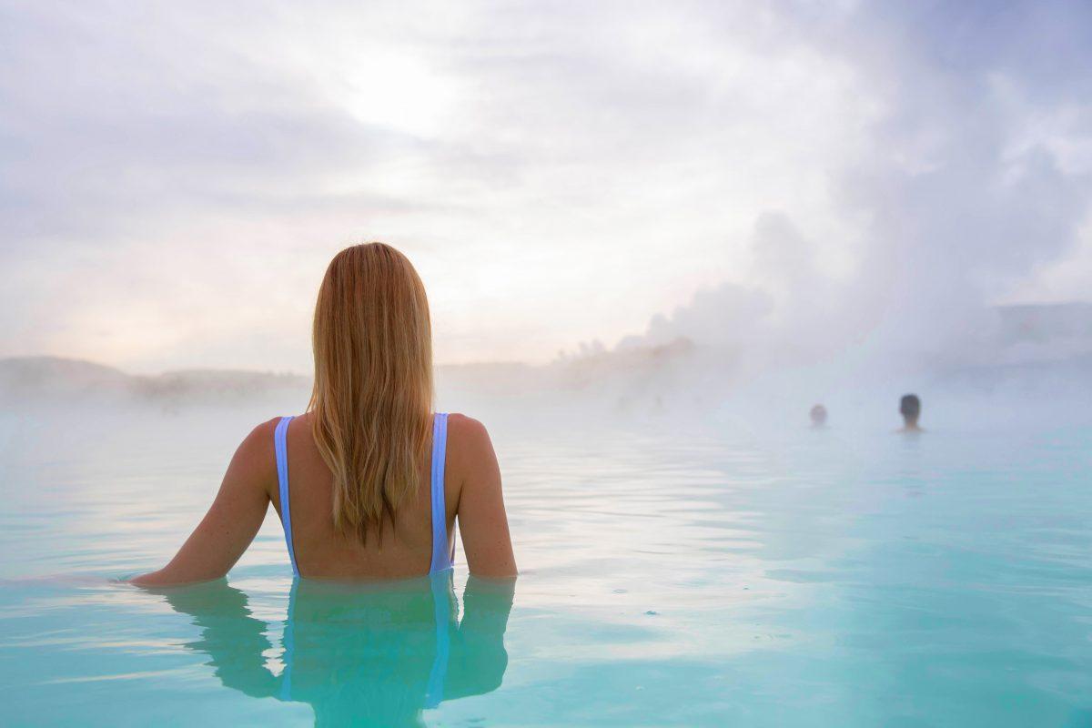 girl bathing in blue lagoon iceland