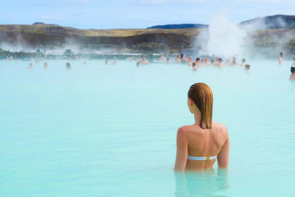 woman enjoys bathing in blue lagoon iceland