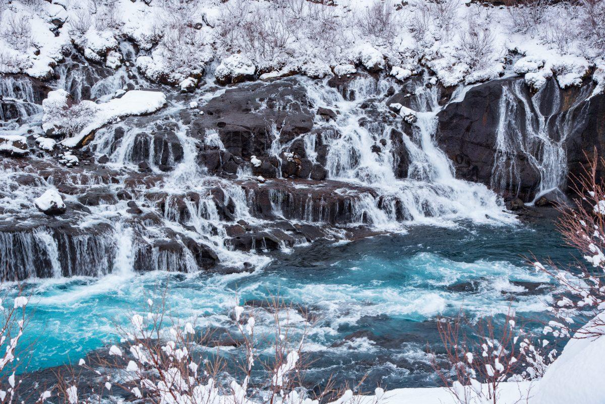 hraunfossar waterfall in winter