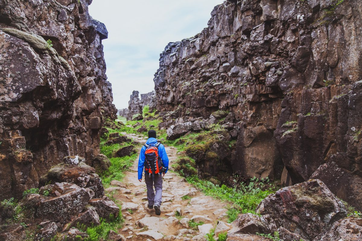 Hiker walking the Þakgil trails.