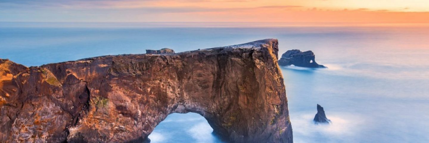 Dyrholaey arch by the sea in south iceland