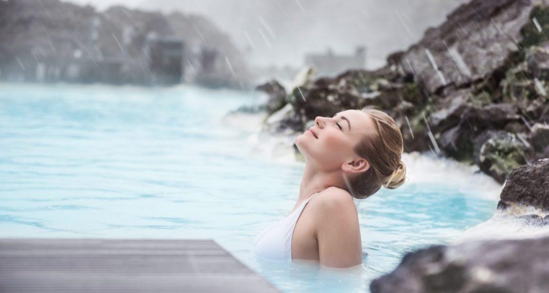 girl enjoying blue lagoon iceland