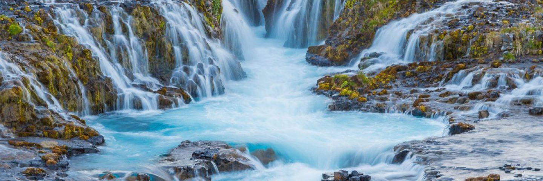 Bruarfoss waterfall shows beautiful blue colors