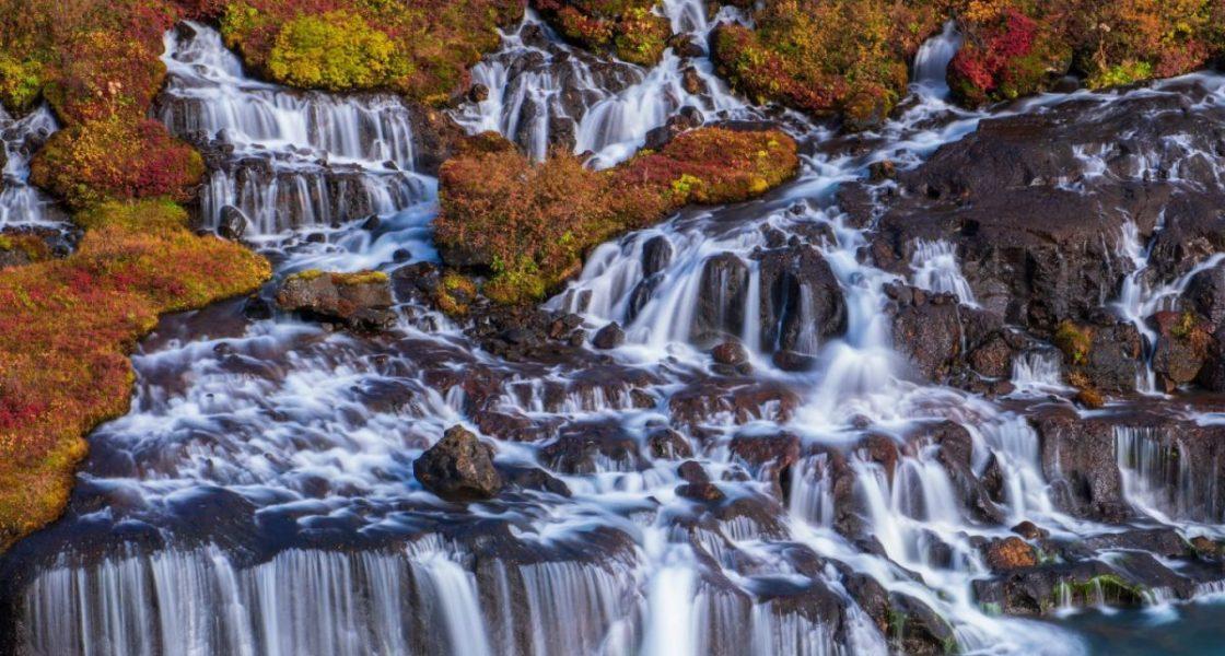hraunfossar waterfall seeping through lava field in west iceland