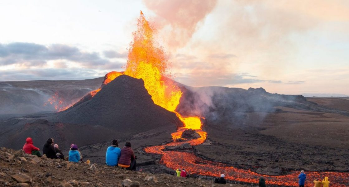 people watching Fagradalsfjall volcano eruption in iceland