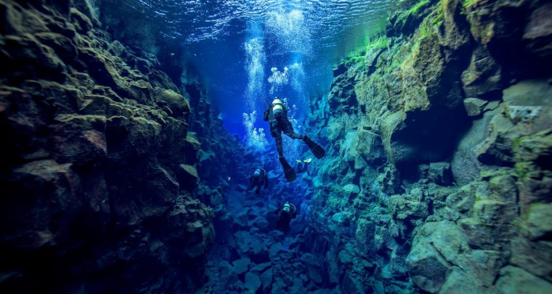 snorkelling between the continents in iceland