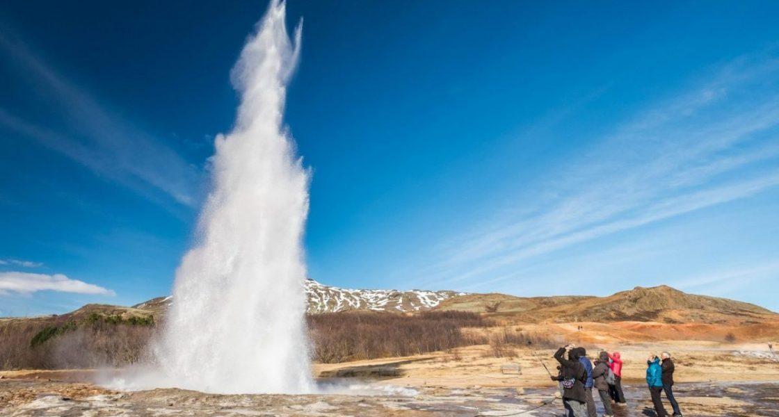 strokkur geyser erupting in iceland
