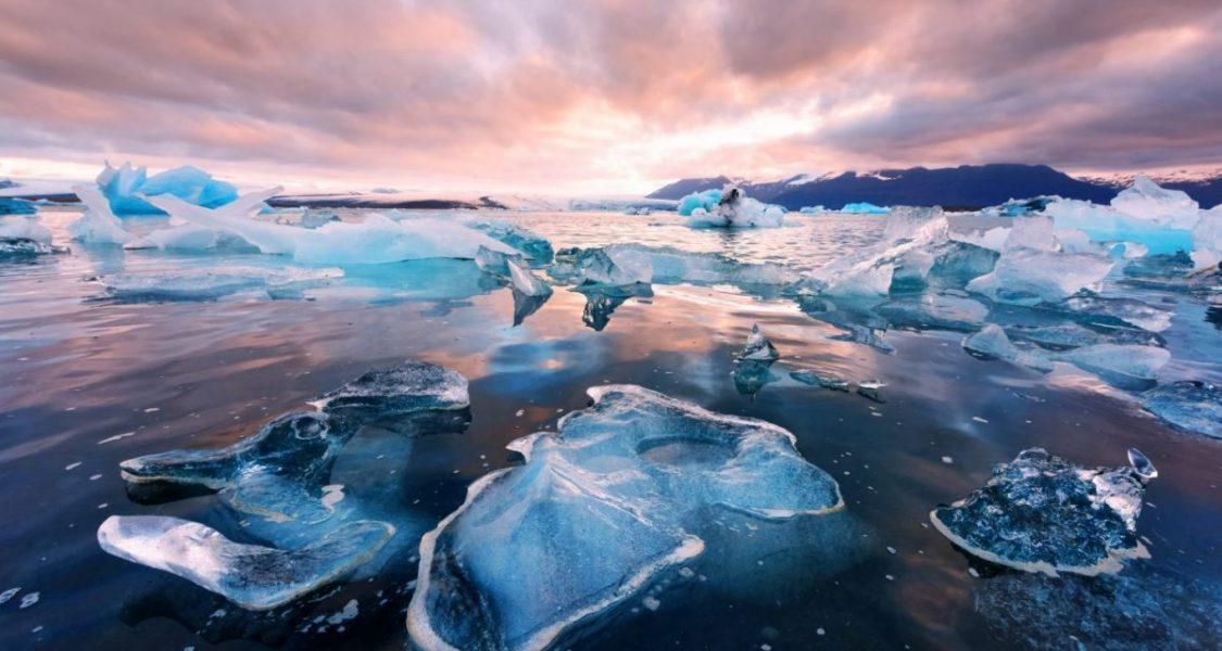 blue ice that looks like diamond on black sand beach iceland